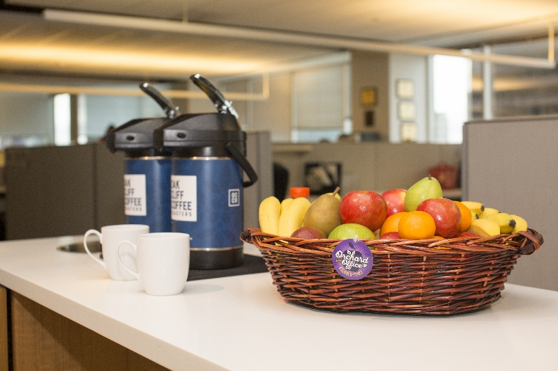 Fresh fruit basket by coffee dispensers