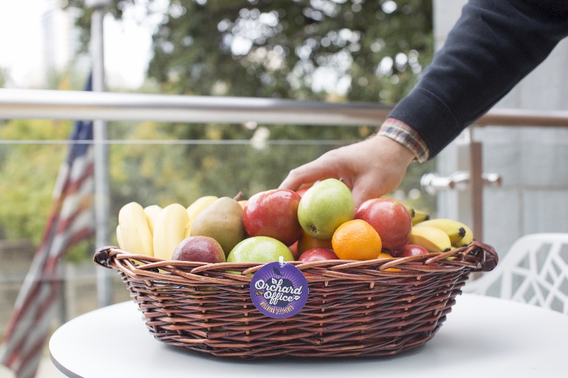 Fruit basket on office patio with American flag in background