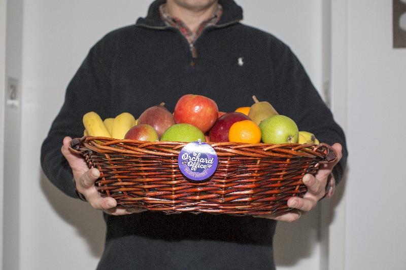Man holding fresh fruit basket