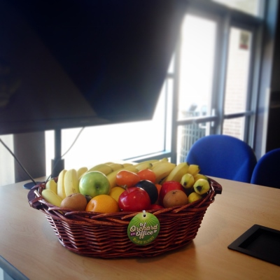 Fruit basket in office training session setting