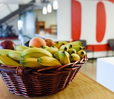 Basket of bananas with large red D in the background