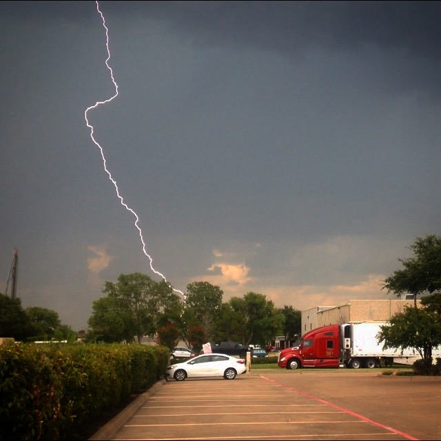Lightning during a storm near an industrial park in Texas