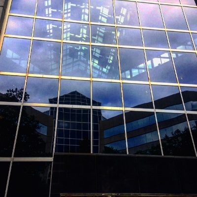 Stylized reflections off glass office building