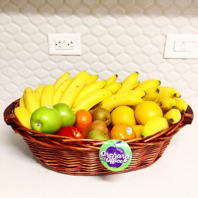 Fruit basket in kitchen with white backsplash
