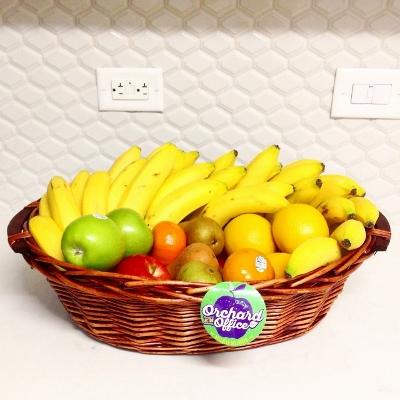 Fruit basket in kitchen with white backsplash