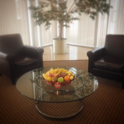 Fruit basket on glass table of office foyer