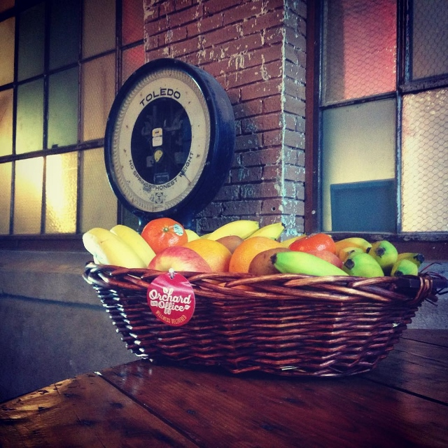 Fruit basket displayed in old red brick building with Toledo scale