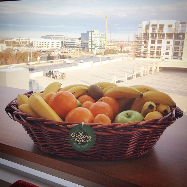 Fruit basket on table overlooking buildings under construction