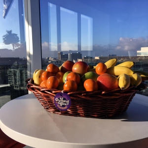 A fruit basket in a high rise kitchen