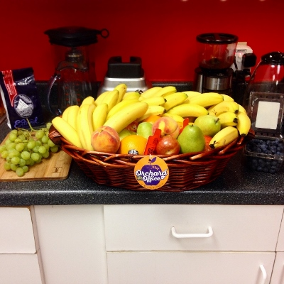 Fruit basket in office kitchen with red backsplash