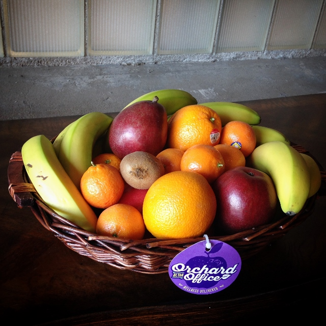 A wicker basket of high-quality fresh fruit