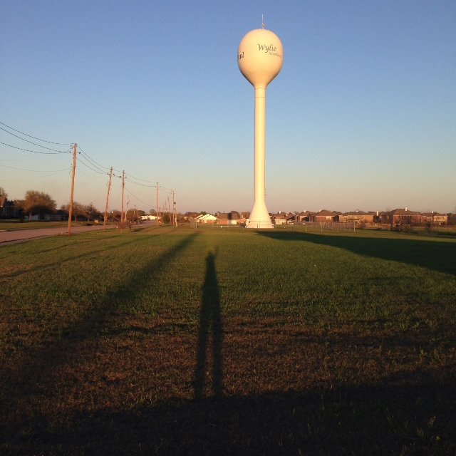 Shadows at sunset in Wylie, Texas facing water tower.