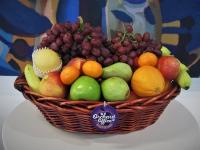 Fresh fruit basket displayed in wicker basket