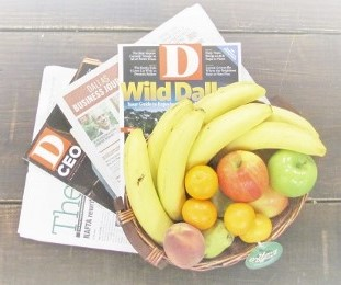 Fresh fruit delivery displayed with magazines